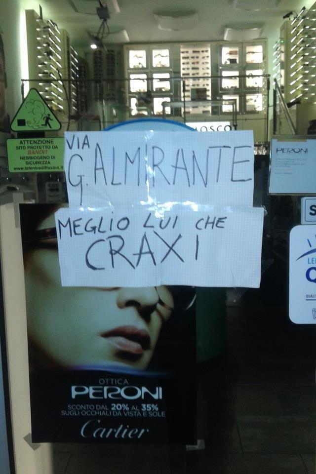manifesto davanti negozio peroni